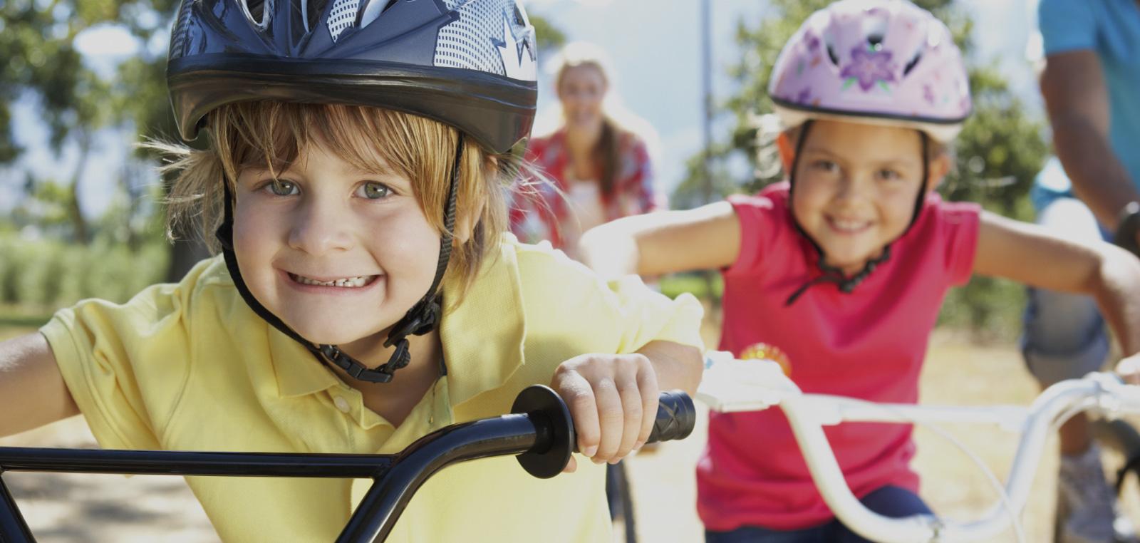 kids riding bikes smiling